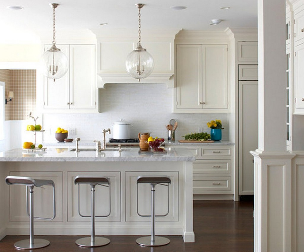 Bistro-touches-white-kitchen-interior-design-ideas-with-marble-countertop-midcentury-kitchen-island-and-modern-bar-stools-in-a-beach-cottage-1024x850
